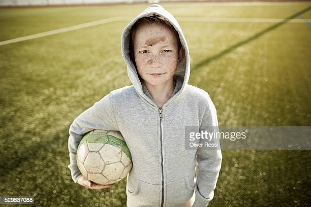 Boy with ball on soccer field
