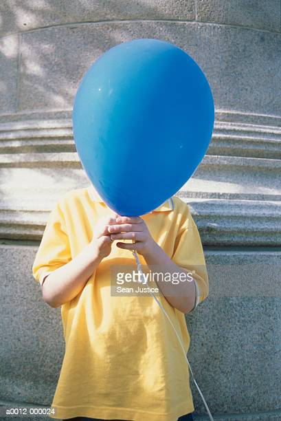 Boy with Balloon Covering Face
