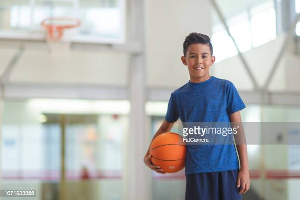 boy with basketball - physical education stock pictures, royalty-free photos & images