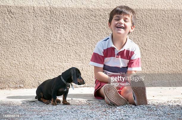 Boy with basset hound