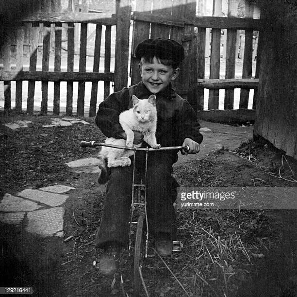 Boy with bike and cat