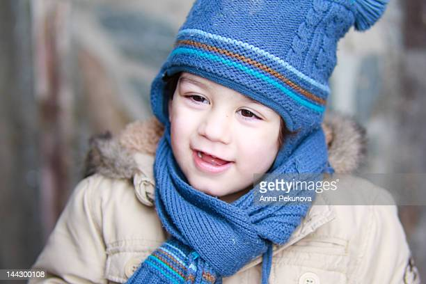 Boy with blue hat and scarf