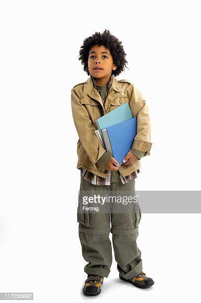 boy with books looking out of frame - out of frame stock pictures, royalty-free photos & images