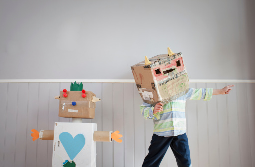 Boy with box covering head and homemade toy robot - gettyimageskorea