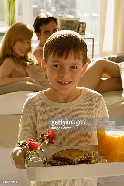 Boy with breakfast for parents