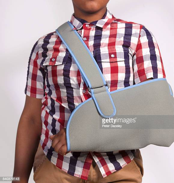 boy with broken arm - arm sling stock pictures, royalty-free photos & images