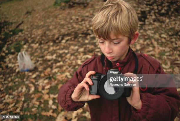 boy with camera - bialowieza forest stock pictures, royalty-free photos & images
