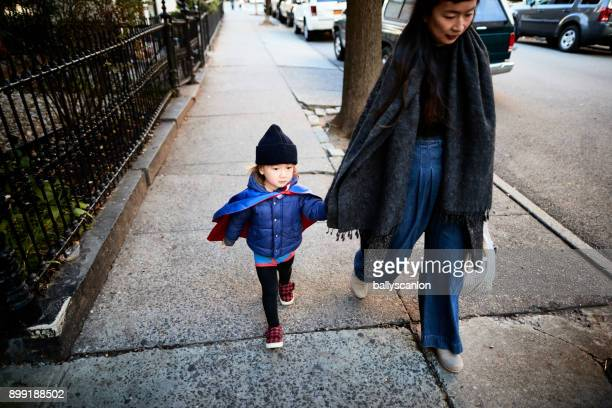 Boy With Cape, Walking With Mother