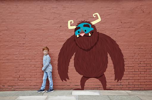 Boy with cartoon monster - gettyimageskorea