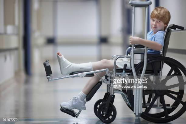 Boy with cast in wheelchair