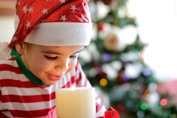 Boy With Christmas Candle