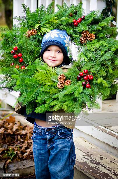 """boy with christmas wreath - """"danielle donders"""" stock pictures, royalty-free photos & images"""