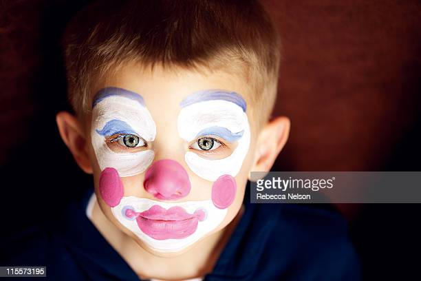 Boy with clown face paint