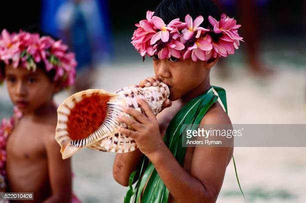 Boy with Conch Shell and Head Flower Wreath