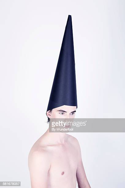 Boy with cone shaped paper hat