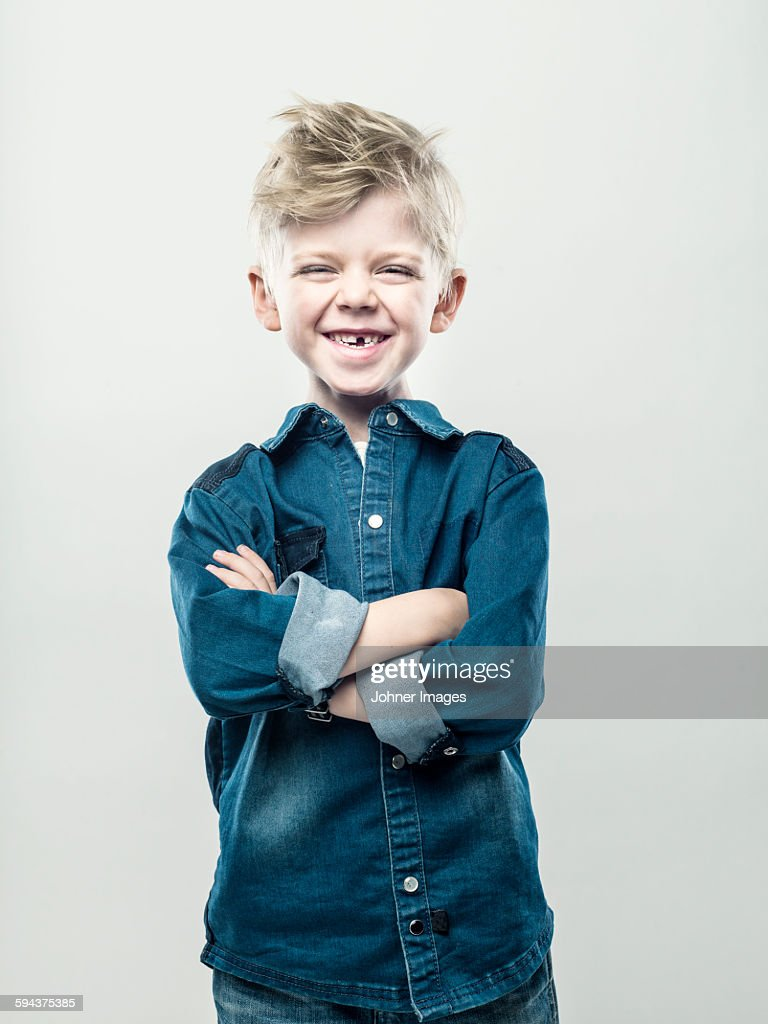 Boy with crossed arms : Stock Photo