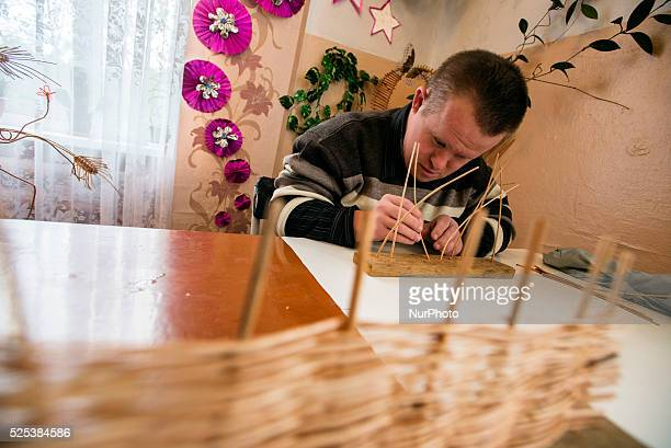 Boy with Down's syndrome canes willows in the class of working therapy Teterivka's Orphanage and Boarding school Zhytomyr Ukraine 2 of February 2015...