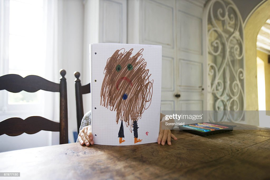Boy with drawing : Stock Photo