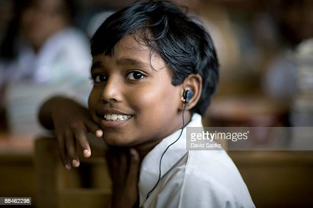 boy with earpiece - sri lanka stock pictures, royalty-free photos & images