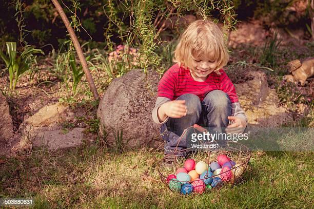 Boy with Easter basket in garden