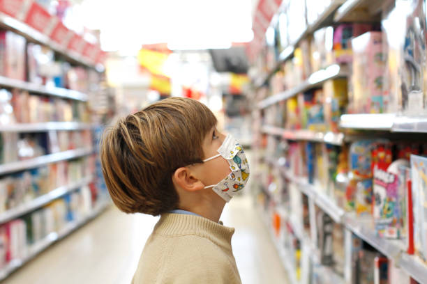 Boy with face mask at toy store