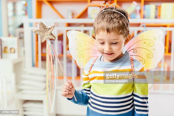 boy with fairy wings, crown and magic wand