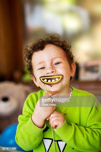boy with fake smile