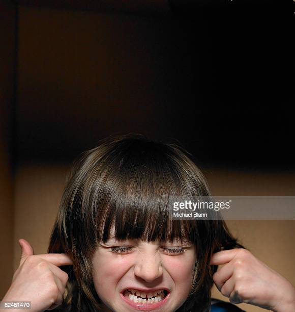 boy with fingers in ears - fingers in ears stock pictures, royalty-free photos & images