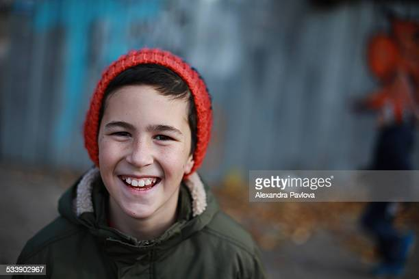 Boy with freckles smiling happily