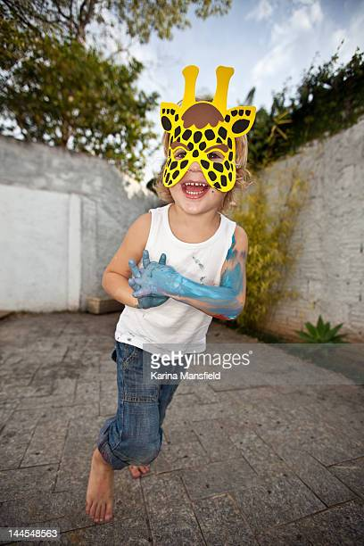 boy with girafe's mask and paint - girafe stock pictures, royalty-free photos & images
