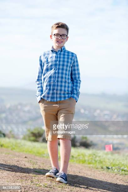 boy with glasses standing in a footpath - checked pattern stock pictures, royalty-free photos & images