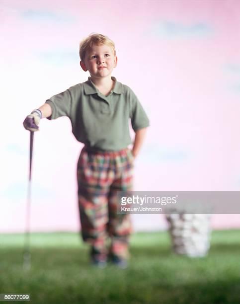 Boy with golf club