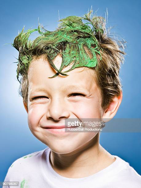 boy with green stuff in his hair