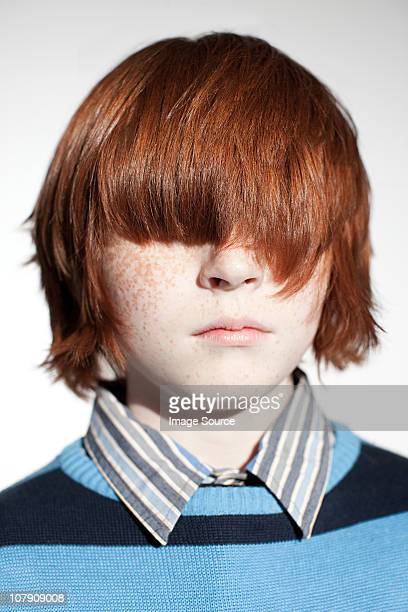 Boy with hair covering his eyes