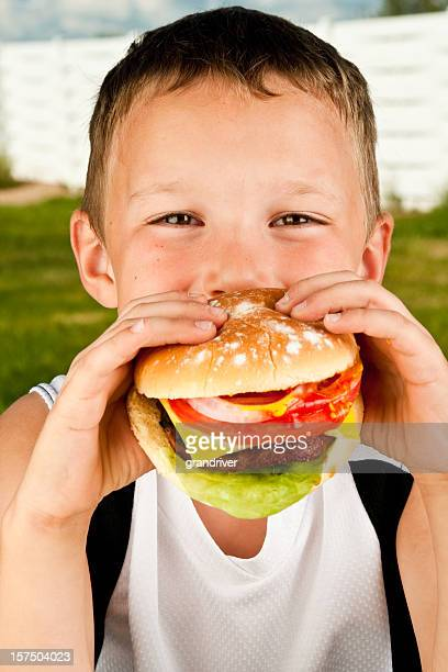 boy with hamburger - mustard gas stock photos and pictures