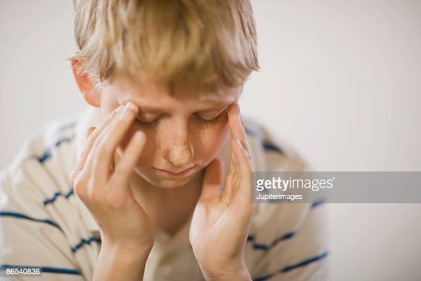 Boy with hands on head