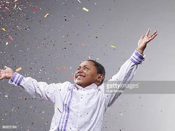 boy with hands up, confetti flying - flying solo after party bildbanksfoton och bilder