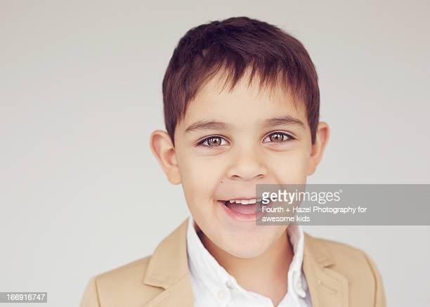 Boy with hazel eyes in suit jacket