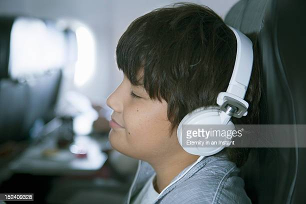 Boy with headphones in aircraft