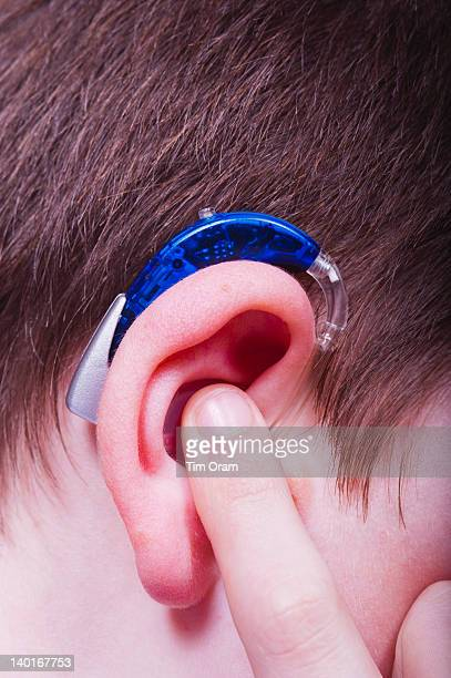 boy with hearing aid - children only stock pictures, royalty-free photos & images