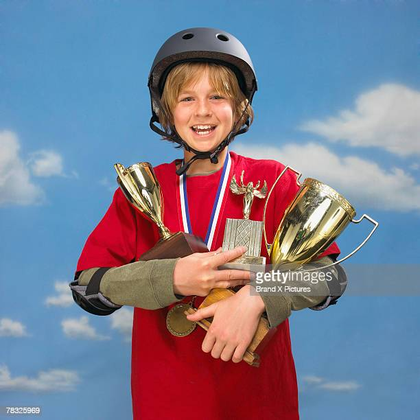 Boy with helmet and trophies