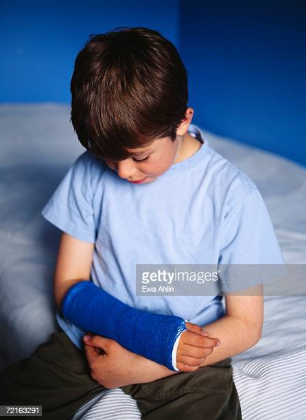 Boy with his arm in plaster.