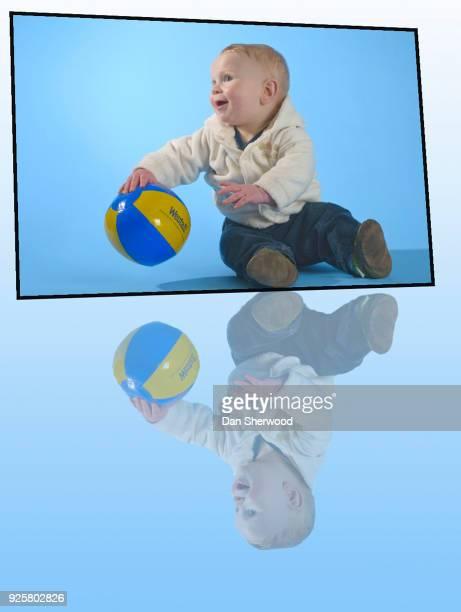 boy with his ball on his 9 month birthday - dan sherwood photography stock pictures, royalty-free photos & images