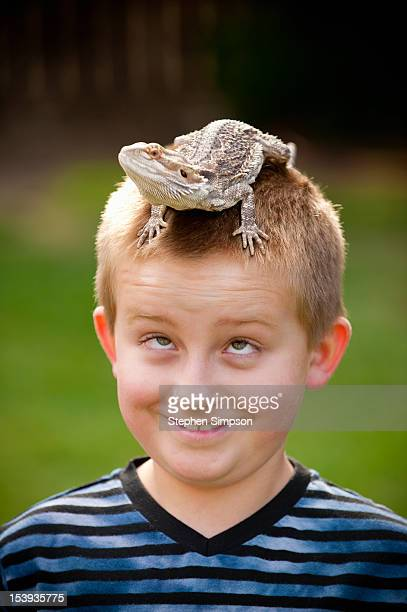 boy with his bearded dragon lizard