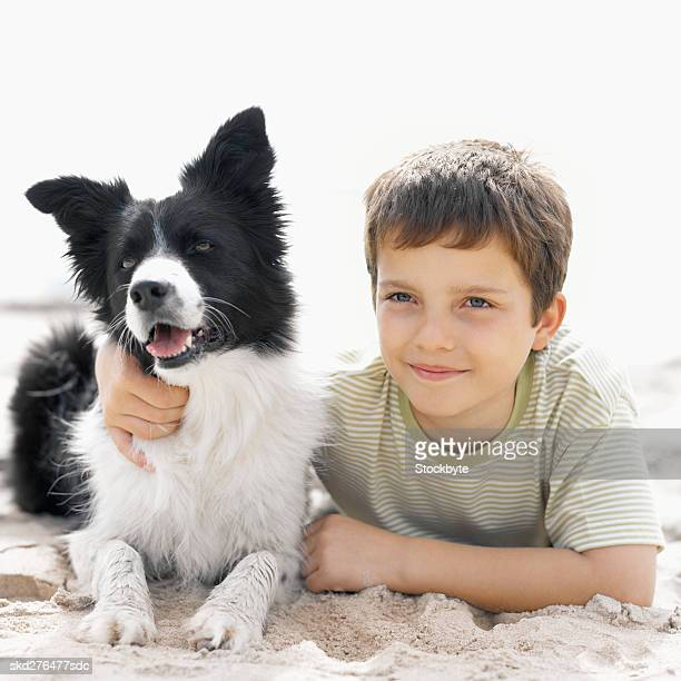 Boy (10-11) with his dog