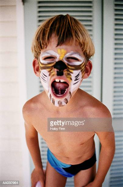 boy with his face painted - speedo boy stock photos and pictures
