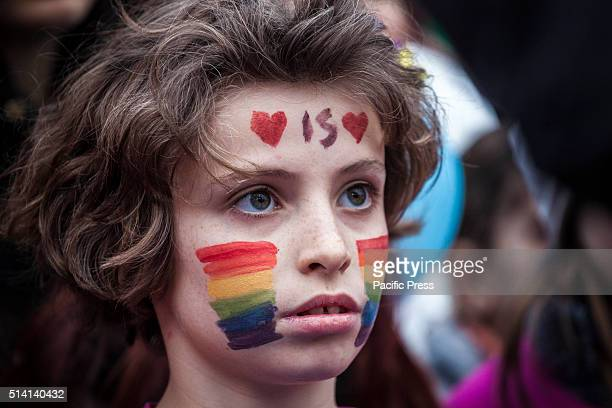 A boy with his face painted takes part in a protest against the bill on civil union which was approved recently by the Italian Senate Thousands of...