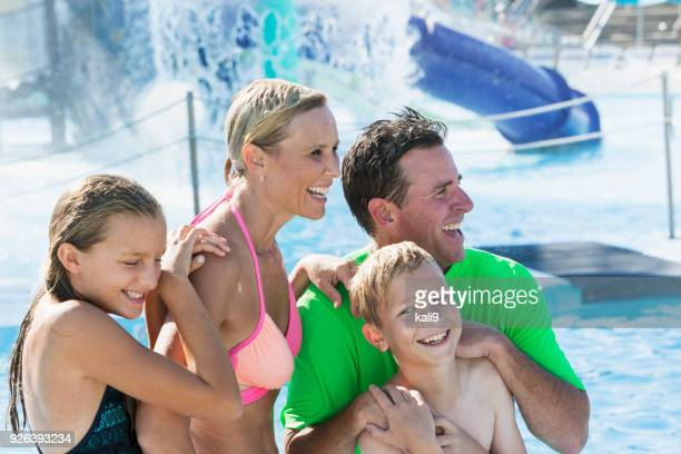Boy with his family having fun at water park