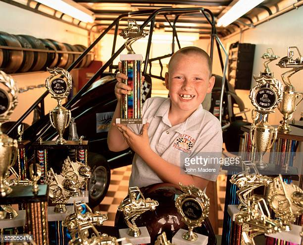 boy with his midget car racing trophies - midget stock pictures, royalty-free photos & images
