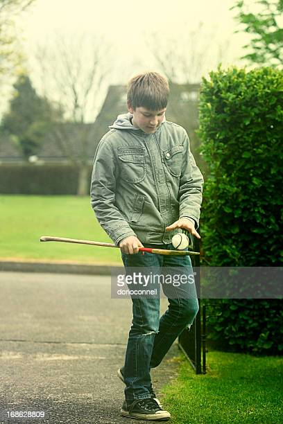boy with hurley and sliotar - traditional sport stock photos and pictures